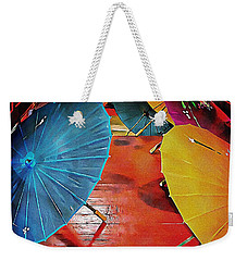 Weekender Tote Bag featuring the photograph A Crowd Of Parasols by Dorothy Berry-Lound