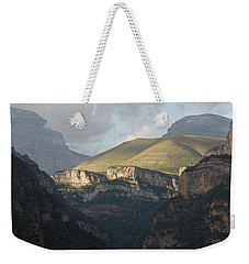 Weekender Tote Bag featuring the photograph A Dash Of Light In The Canyon Anisclo by Stephen Taylor