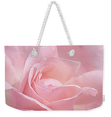 Weekender Tote Bag featuring the photograph A Delicate Pink Rose by Susan Rissi Tregoning
