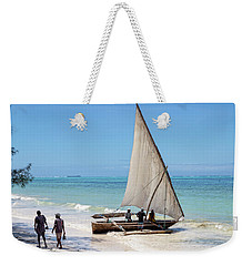 Weekender Tote Bag featuring the photograph A Dhow In Zanzibar by Kay Brewer