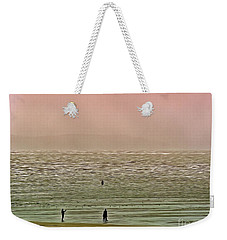Weekender Tote Bag featuring the photograph A Distant Shore by Leigh Kemp