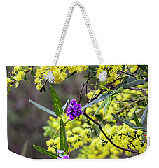 Weekender Tote Bag featuring the photograph A Little Bit Of Purple Coral Pea by Elaine Teague