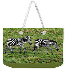 Weekender Tote Bag featuring the photograph A Pair Of Zebras by Kay Brewer