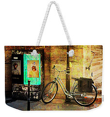 Weekender Tote Bag featuring the photograph A Saint Bicycle Of All Seasons II by Craig J Satterlee