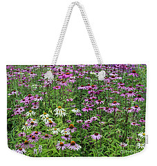 Weekender Tote Bag featuring the photograph A Sea Of Echinacea Coneflowers by Tim Gainey