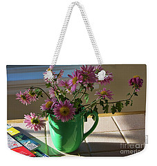 Weekender Tote Bag featuring the photograph A Traveler Still Life With Autumn Flowers by Tatiana Travelways