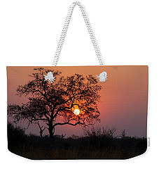 Weekender Tote Bag featuring the photograph Africa Sunset by John Rodrigues