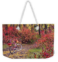 Weekender Tote Bag featuring the photograph An Autumn Bike Trek by Leland D Howard