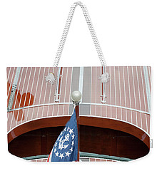 Weekender Tote Bag featuring the photograph Antique Wooden Boat With Flag 1303 by Rick Veldman