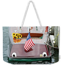 Weekender Tote Bag featuring the photograph Antique Wooden Boat With Flag And Flowers 1304 by Rick Veldman