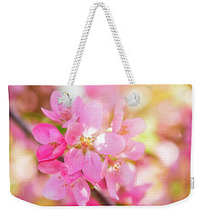 Weekender Tote Bag featuring the photograph Apple Blossoms Cheerful Glow by Leland D Howard
