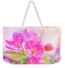 Weekender Tote Bag featuring the photograph Apple Blossoms Colorful Glow by Leland D Howard