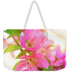 Weekender Tote Bag featuring the photograph Apple Blossoms Warm Glow by Leland D Howard