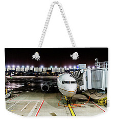 Weekender Tote Bag featuring the photograph Arrivals And Departure On Airplane At The Airport by Alex Grichenko