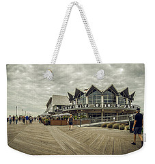 Weekender Tote Bag featuring the photograph Asbury Park Boardwalk Looking South by Steve Stanger