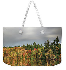 Weekender Tote Bag featuring the photograph Autumn Tree Reflections by Grant Glendinning