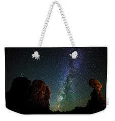 Weekender Tote Bag featuring the photograph Balancing Act by Andy Crawford