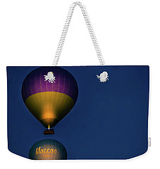 Weekender Tote Bag featuring the photograph Balloons And The Moon by Francisco Gomez