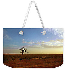 Weekender Tote Bag featuring the photograph Baobab Tree At Sunset by Mark Duehmig