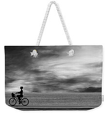 Weekender Tote Bag featuring the photograph Biking On Pch by John Rodrigues