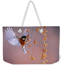 Weekender Tote Bag featuring the photograph Bird Eating On The Fly by Top Wallpapers