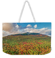 Weekender Tote Bag featuring the photograph Blanketed In Color by Michael Hughes