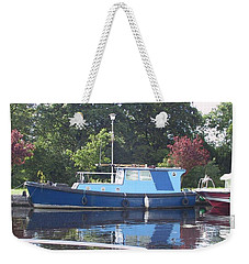 Weekender Tote Bag featuring the painting Blue Boat At Cloondara Harbour. by Val Byrne