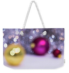Weekender Tote Bag featuring the photograph Blurry Christmas Background With Christmas Balls And Bokeh by Cristina Stefan