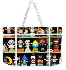 Weekender Tote Bag featuring the photograph Bobbleheads In Store Window In Schroon Lake Ny In Adirondacks by Rose Santuci-Sofranko