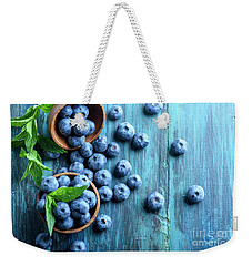 Bowl Of Fresh Blueberries On Blue Rustic Wooden Table From Above Weekender Tote Bag