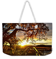 Weekender Tote Bag featuring the photograph Breaking Sunset by Robert Knight