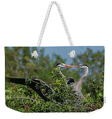 Weekender Tote Bag featuring the photograph Breeding Herons by Donald Brown