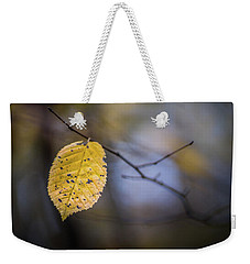 Weekender Tote Bag featuring the photograph Bright Fall Leaf 1 by Michael Arend
