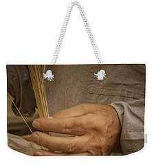 Weekender Tote Bag featuring the photograph Broom  Maker by Guy Whiteley