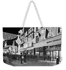 Weekender Tote Bag featuring the photograph Brown Thomas On Grafton Street At Night - Dublin by Barry O Carroll