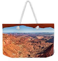 Weekender Tote Bag featuring the photograph Buck Canyon Through Mesa Arch by Andy Crawford