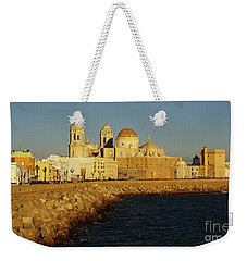 Weekender Tote Bag featuring the photograph Cadiz Cathedral From Southern Field Spain by Pablo Avanzini