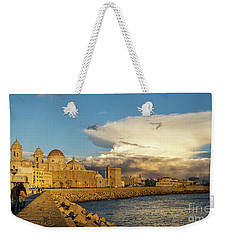 Weekender Tote Bag featuring the photograph Cadiz Skyline And Cathedral Under Cumulonimbus by Pablo Avanzini
