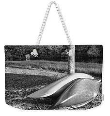 Weekender Tote Bag featuring the photograph Canoes And A Boathouse Bnw by Rachel Hannah