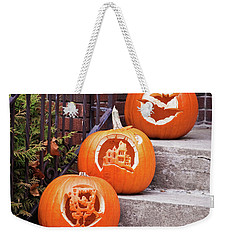 Weekender Tote Bag featuring the photograph Carved Pumpkins For Autumn Holidays by Tatiana Travelways