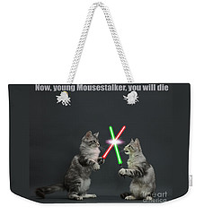Weekender Tote Bag featuring the photograph Cat Wars by Warren Photographic
