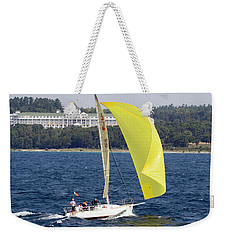 Weekender Tote Bag featuring the photograph Chicago To Mackinac Yacht Race Sailboat With Grand Hotel by Rick Veldman