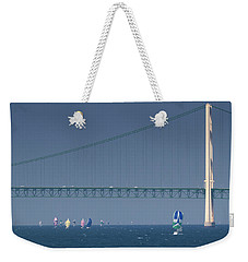 Weekender Tote Bag featuring the photograph Chicago To Mackinac Yacht Race Sailboats With Mackinac Bridge by Rick Veldman