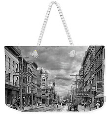 Weekender Tote Bag featuring the photograph City - Poughkeepsie Ny - The Ever Changing Market Place 1906 - Black And White by Mike Savad