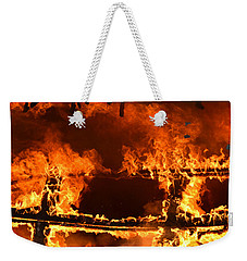 Weekender Tote Bag featuring the photograph Consumed by Carl Young