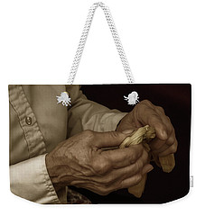 Weekender Tote Bag featuring the photograph Corn Husk Doll Maker by Guy Whiteley