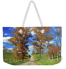 Weekender Tote Bag featuring the photograph Country Road Through Fall Trees by Angela Murdock