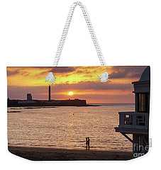 Weekender Tote Bag featuring the photograph Couple At Sunset In La Caleta Cadiz Spain by Pablo Avanzini