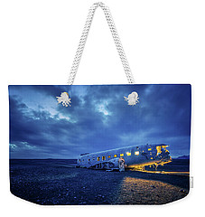 Weekender Tote Bag featuring the photograph Dc-3 Plane Wreck Illuminated Night Iceland by Nathan Bush
