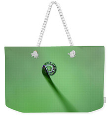 Weekender Tote Bag featuring the photograph Dew Drop On Grass by John Rodrigues